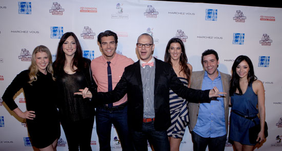 Peter Paige (center) and Hollywood Rush cast members