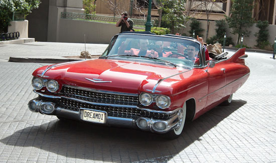 The cast of Jersey Boys arrive in a vintage 1959 red Cadillac Convertible