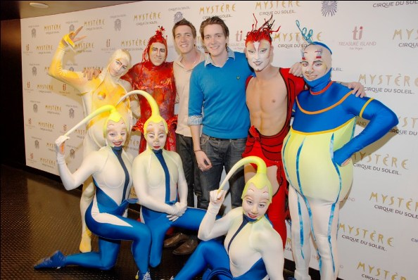 James and Oliver Phelps and cast members of Mystère