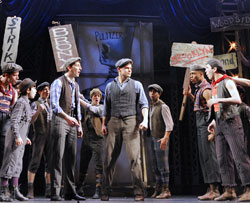 Jeremy Jordan (center) and company
