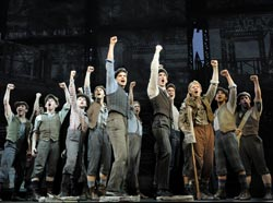 Jeremy Jordan and company in Newsies