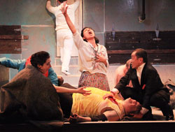 Jolly Abraham (center) and company