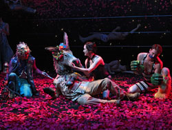 Steven Skybell and Bebe Neuwirth (center)