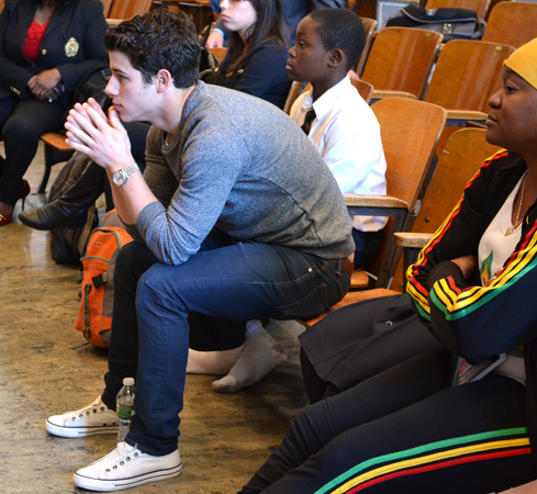 Nick Jonas observes a student rehearsal at MS 61 in Brooklyn