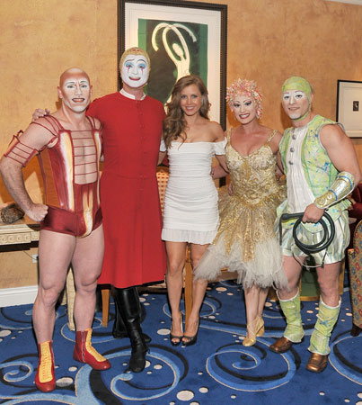 Amy Adams with cast members from Cirque du Soleil's O