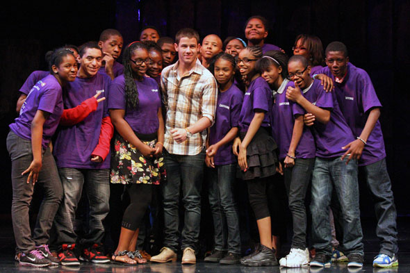 Nick Jonas (center) with Broadway JR. Students
