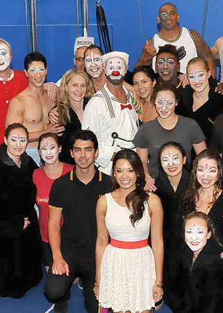 Joe Jonas with cast members from Cirque du Soleil's O