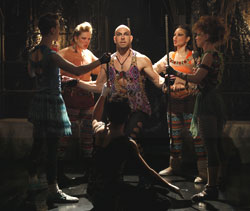 Wade McCollum (center) and company in Triassic Parq The Musical (© Carol Rosegg)