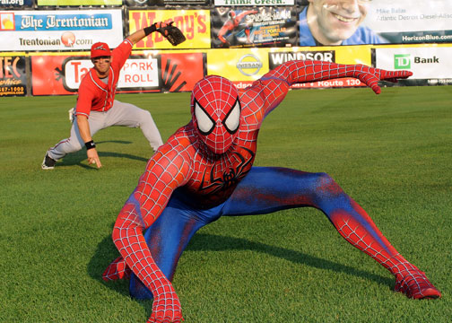 Spider-Man and a Richmond player strike a Spidey pose (Courtesy of the Trenton Thunder)