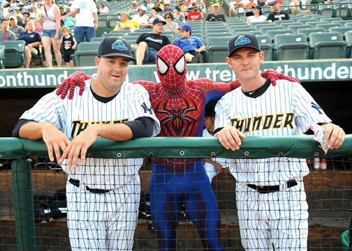 Spider-Man with players in the dugout (Courtesy of the Trenton Thunder)