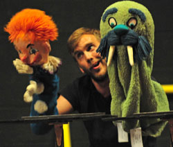 Gus Curry and puppets in rehearsal for Carnival