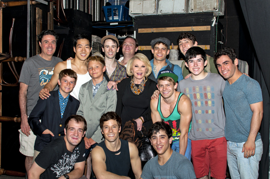 Joan Rivers (center), Cooper, and Julian (left) with the men of Newsies