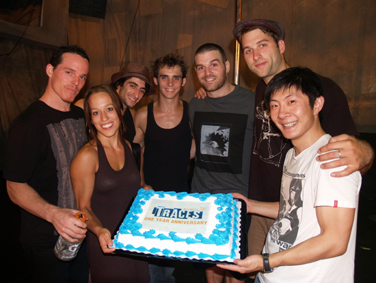 Traces cast members Brad Henderson, Valerie Benoit-Charbonneau, Tarek Rammo,  Lucas Boutin, Philippe Normand-Jenny, Mason Ames and Xia 'Daqi' Zhengqi with their one-year anniversary cake at Union Square Theatre (Courtesy of the company)