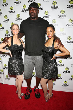 Members of The Rockettes pose with NBA legend Shaquille O'Neal on the 2012 Zumba Instructor's Convention red carpet