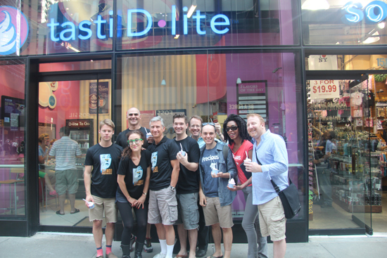 "Randy Harrison, Howard Kaye, Jenn Harris, David Garrison, David Ayers, Doug Trapp, Topher Nuccio, Ronica V. Reddick and Hunter Bell celebrate the new ""Hannibal Nectar"" dessert at the Times Square Tasti D-Lite
