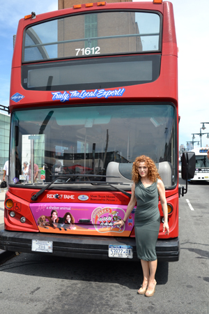 Bernadette Peters with Gray Line New York's red double-decker tour bus which now sports the Broadway Barks logo