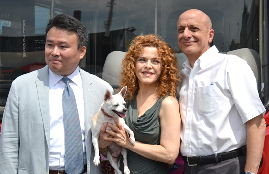 TwinAmerica Director of Marketing David W. Chien, Bernadette Peters with Chachi the chihuahua, and Broadway Cares/Equity Fights AIDS Executive Director Tom Viola