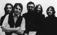 Terry Southern (center) with his pals, The Beatles