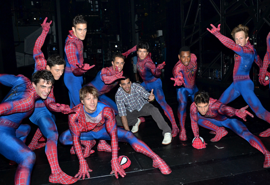 "Danell Leyva (center) strikes his best ""Spider-Man"" pose with the men of the musical on stage at the Foxwoods Theatre