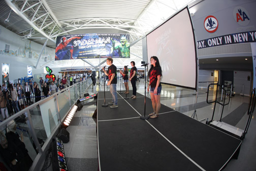 Spider-Man Turn Off the Dark cast members perform at JFK airport's American Airlines terminal