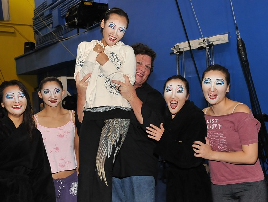 Dot Jones with cast members of Cirque du Soleil's O (© Von Loyrangsy/Cashman Photography)