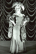 Claudia Shear as Mae West