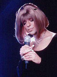Steven Brinberg as Barbra Streisand
