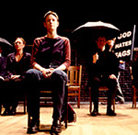 Kelli Simpkins (center) and castin The Laramie Project(Photo by Joan Marcus)