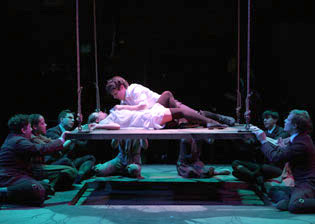 Lea Michele and Jonathan Groff (center) and company